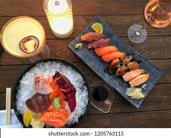 variety of sushi on table