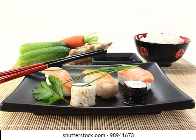 variety of sushi with parsley and chives