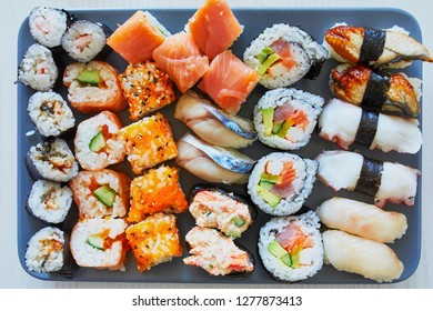 Variety of sushi served on a plate. Japanese food at home or in restaurant. Take away food