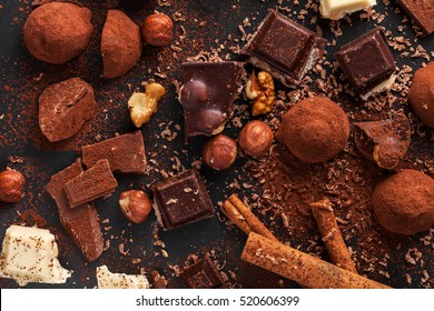 Variety of sweet homemade chocolate pralines on wooden background