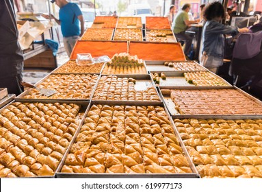 Variety of sweets on the arab street market stall. Eastern sweets in a wide range, baklava, Turkish delight with almond, cashew and pistachio nuts.
