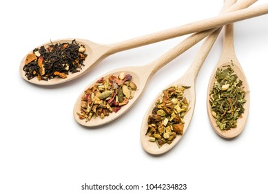 variety of tea blend on wooden spoon on white background