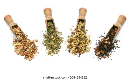 variety of tea blend in wooden scoop on white background