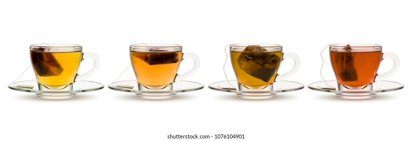 variety of tea and herbal teas in glass cups with tea bag inside, on white background