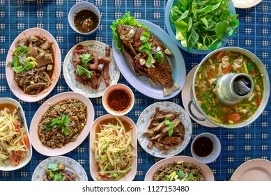 Variety of Thai spice and lime food , grilled stuff party full on table above view - som tum style e san food