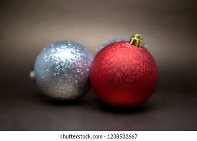 Variety of three Christmas tree decoration balls isolated on a dark background