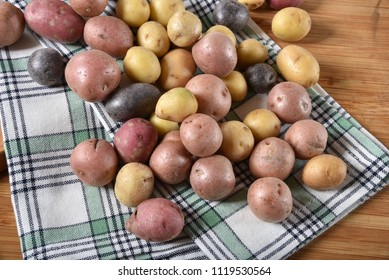 A variety of tiny potatoes on a kitchen towel