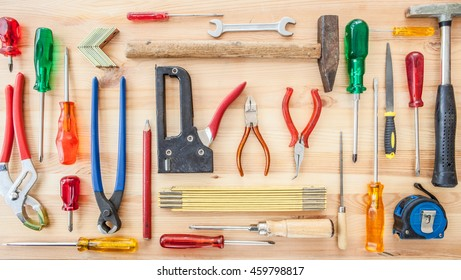 Variety of tools on a rustic wooden background