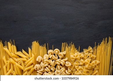 Variety of traditional italian pasta with copy space
