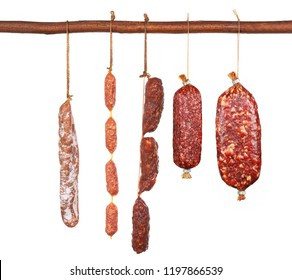 Variety of traditional mini salami isolated upright on a wooden stick
