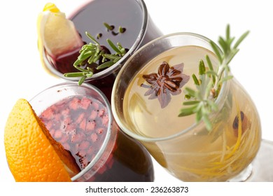 Variety of traditional winter sweet hot alcohol drinks mulled red wine  glintwine and  white rum with orange, spices, cinnamon, rosemary, anise