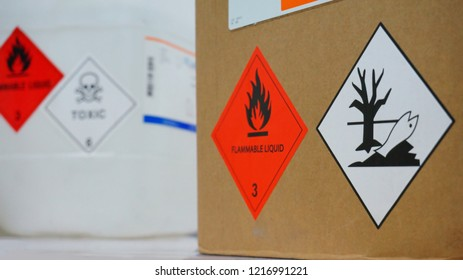 Variety type of chemical container with  many of chemical hazard warning symbols. Flammable warning symbol, Toxic warning symbol, Hazardous to the Environment symbol.