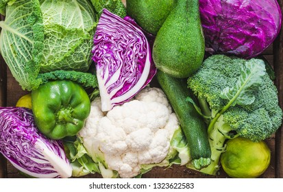 Variety of vegetables cabbages, broccoli, peppers, cauliflower, avocado, zucchini, cucumber.