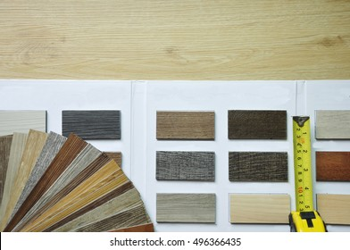 variety of wood Samples of laminate and vinyl floor tile on wooden Background and catalog