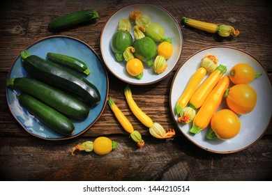 Variety zucchini, squash on a wooden background, top view. Vegetarian diet food concept. Cooking ingredients .