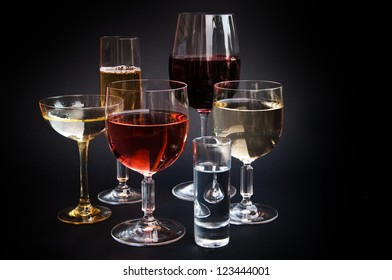 Various alcoholic drinks and wine in different glasses