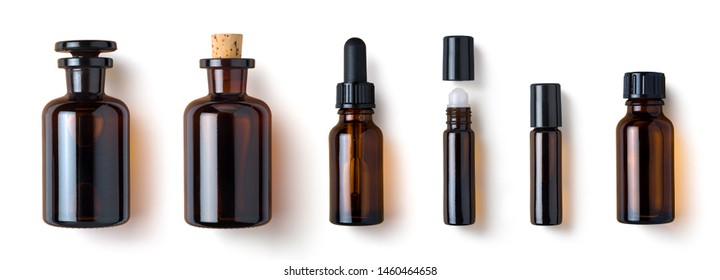 various amber glass bottles for cosmetics, natural medicine , essential oils or other liquids isolated on a white background, top view	 - Shutterstock ID 1460464658