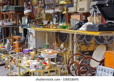 Various antique objects for sale at flea market