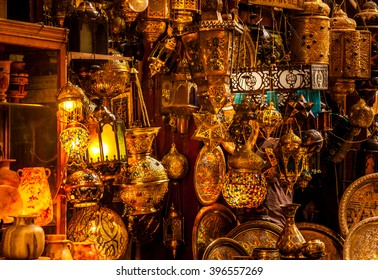 Various arabic antique objects displayed in an old shop in the bazaar. Typical shop in an egyptian market.