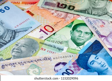 Various Asian currencies, cash pile background
