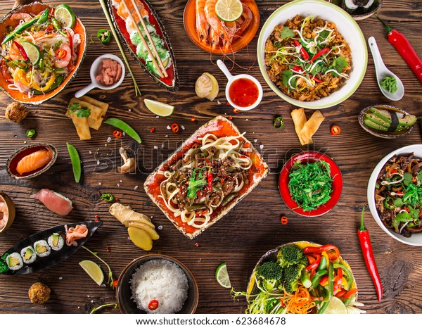 Various of asian meals on rustic background , top view , place for text. Asian food concept.