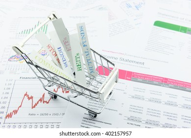 Various asset types in a shopping cart. An ideal investment that diversifies every assets in a portfolio to minimize unsystematic risk for risk averse investors. Financial asset allocation concept.