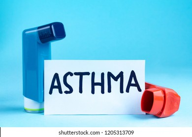 Various asthma inhalers on a blue background. Asthma and copd disease concept
