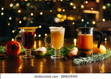 Various autumn or winter seasonal alcohol hot cocktails. Tangerine tea in French press, Mulled pear cider and Mulled wine with persimmon