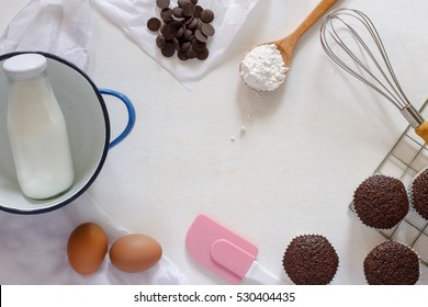 various of baking tool with chocolate muffin on white background.