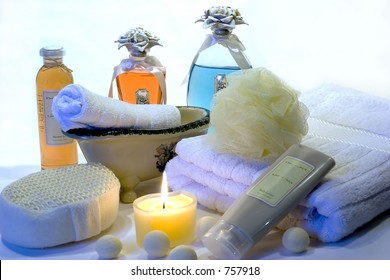 Various bath accessories including a body sponge, loofa, candle, towel, lotion, oil, etc.