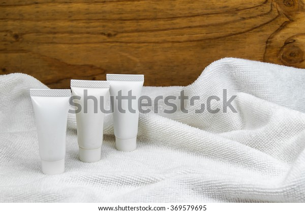various beauty hygiene tubes on towel in spa
