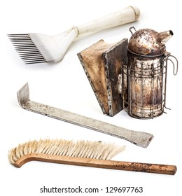 Various beekeeping equipment on white background