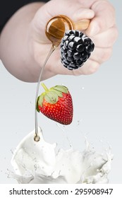 Various Berries Falling Into Milk Splash With Honey Drip