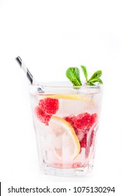 Various berry lemonade or mojito cocktails, fresh iced lemon lime raspberry blueberry infused water, summer healthy detox drinks isolated on white