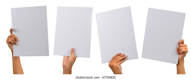 various blank cardboard with hands isolated on white