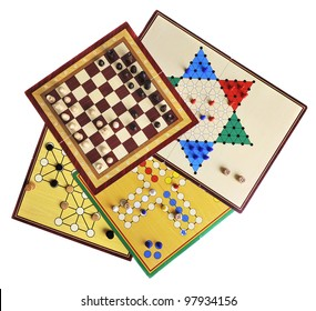 Various board games of ludo, halma, chess and fox and geese isolated on white