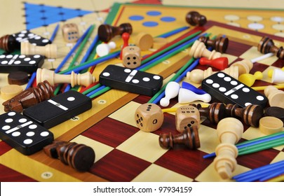 Various board games and many figurines background