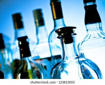 Various bottles at a bar arranged in rows