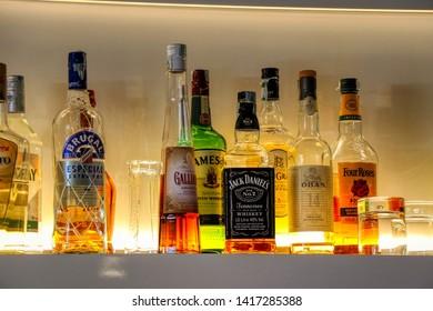 Various bottles of Scotch whiskey at the bar. Taranto, Puglia, Italy - 06/06/2019
