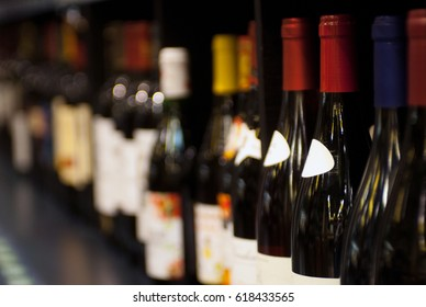 various bottles of wine on the shelf. selective focus