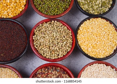 Various bowls of spices over wooden background. Colours and textures