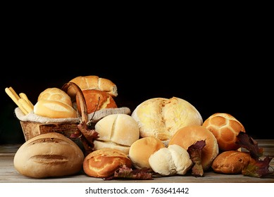 various bread on wood background