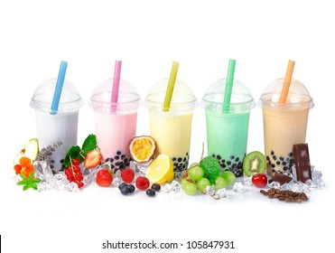 Various Bubble Tea in a row isolated on white background with different fruits.