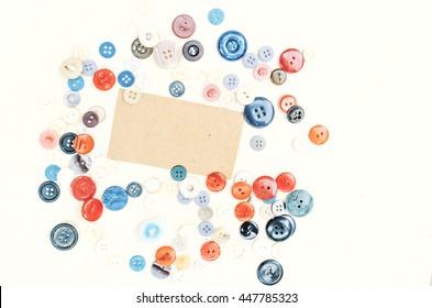 Various buttons composition, wooden background, vintage paper background, mock up