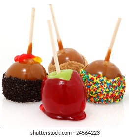 Various candied apples on a stick.