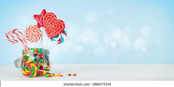 Various candy sweets and lollipop. With copy space