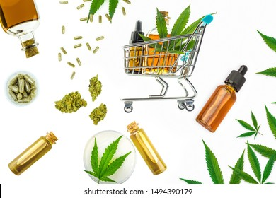 Various Cannabis products, CBD THC oils, pills, paste, gel lotion flower buds and shopping trolley isolated on white