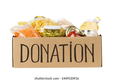 Various canned food, pasta and cereals in a cardboard box. Food donations concept. Isolated on white.