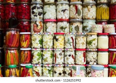 Various canned vegetables and cheese in the glass jars.