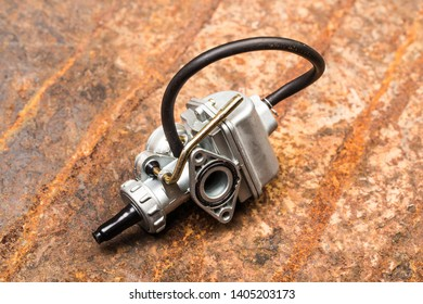 Various car parts and accessories, on metal  background carburetor